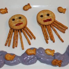 I made them a ritz cracker and pretzel octopus snack.  I used peanut butter in the crackers and then just stuffed the pretzels in there.  Then blueberry yogurt with an added drop of blue food coloring for the water and  a few pretzel goldfish for swimming.