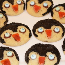 I made these penguin cookies.  Well, I didn't bake them.  I am in the middle of Jenny Craig and this day I just knew I couldn't handle the smell of anything fresh baked wafting through my kitchen.  SO, i bought some regular old sugar cookies, tinted some choclate frosting black and added eyes and a beak using candy.